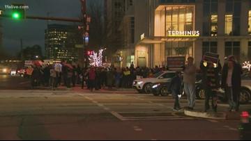 Dozens rally against President Trump in Atlanta