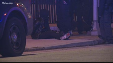 Officer-involved shootout leaves one person dead and two others hurt