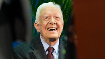 Jimmy Carter is walking, in 'good spirits' following brain surgery