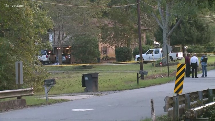 Man accused of fatal shooting, holding woman and child hostage
