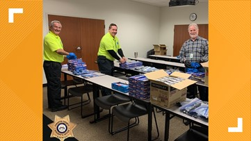 Volunteers pack protective kits for deputies in Forsyth County