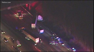 Cars trapped under tractor trailer after crash blocking all lanes on I-20
